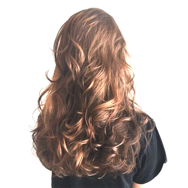 woman curly hairstyle at the best salon in plano