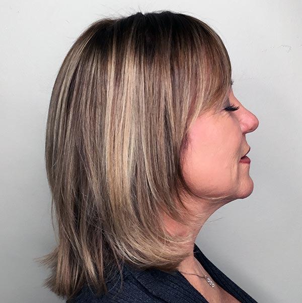 womans haircut after salon visit