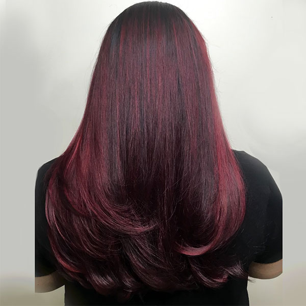 red violet balayage womans hair coloring