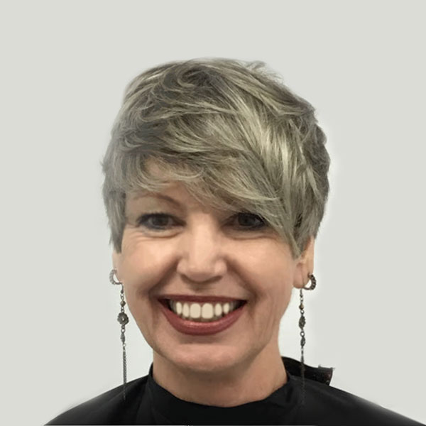 womans haircut short blonde hairstyle with bangs