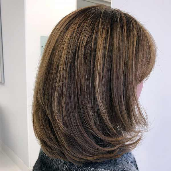 womans short hairstyle side veiw plano texas