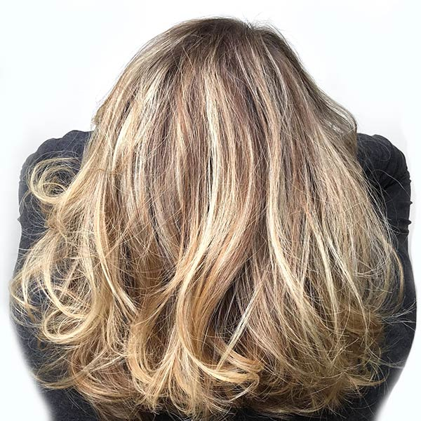 womans highlights on hair at the best salon near me in plano