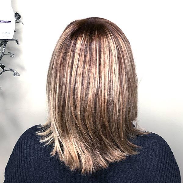 after womans color correction hair salon service