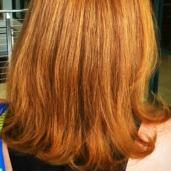red hair coloring on woman at the salon