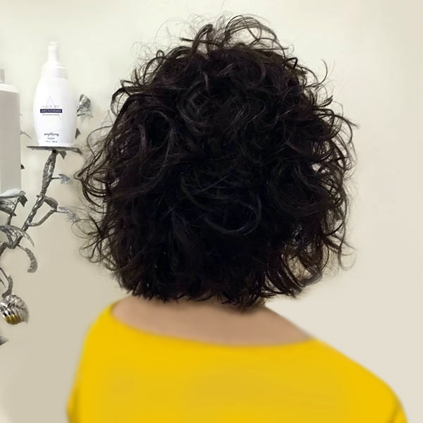 womans naturally curly hairstyle salon plano texas